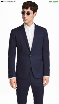 c174cba2c0a5a Single-button blazer in textured-weave stretch fabric. Pointed lapels with  decorative buttonhole. Chest pocket, front pockets with flap, and