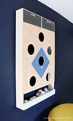 ana white Bean bag toss on the wall! This bean bag toss game works is easy to build and hangs on the wall with our french cleat system. We love how it adds a decor or art element to a space. Woodworking Projects Diy, Diy Wood Projects, Wood Crafts, Diy Crafts, Woodworking Shop, Ana White, White Bean Bags, Backyard Games, Outdoor Yard Games