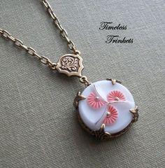 Antique milk glass button made into a necklace