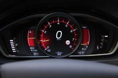 2013 Volvo V40. Main instruments are in a panel that can be put into one of 3 modes: green for the Eco mode; a brown for Elegance with the temperature indicator changing to a fuel efficiency gauge; red for Performance with the big center speedometer changing to the tachometer and right-side gearshift indicator changing to a power meter.