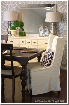 Hello chunky curved legs... and those upholstered chairs. Perfect inspiration for my dining room.
