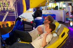 A wheelchair user and his aide bond over some intense race car arcade games.   #101mobility #access #games