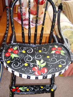 High chair painted Mary Englbreight style.