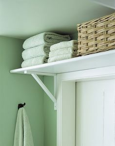 Shelves above the bathroom door - great idea when space is limited