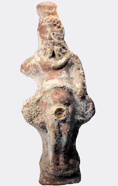 Roman Priapus, 1st century A.D. Roman Egypt hollow moulded pottery figure of a priapic deity with a long flowing beard and cylindrical headdress, 18 cm high. Private collection