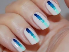 White nails with blue ombré dots