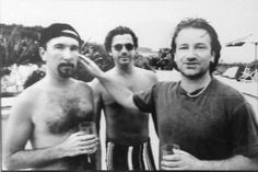 What an awesome shot ! The Edge, Michael Hutchence and Bono...