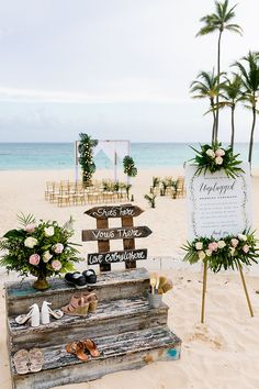 Beach shoe rack for a destination wedding in Punta Cana and tropical theme unplugged ceremony sign.