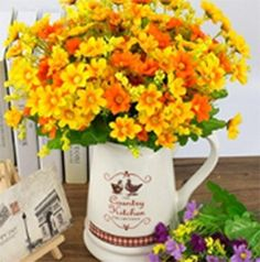 cool  Flower material : Silk and Plastic, environmental and artificial. 2 Pack Package: Each of the five branches has 10 flowers. If your vase is big, we suggest you to buy two or three.   https://www.silkyflowerstore.com/product/3-pcs-plastic-artificial-flowers-daisy-flowers-fake-silk-flowers-home-decorative-party-wedding/
