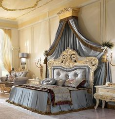 Double bed in carved wood and upholstered headboard