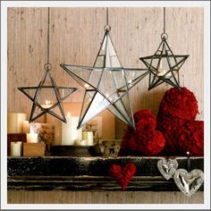 Star lantern. Ready. Set. Glow. Our beautiful glass and iron lanterns may be hung indoors or under an outdoor covered porch. The glass panes with iron framework form these handsome star shaped lanterns. Each lantern holds a single tealight candle and hangs from a chain.