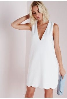Work this fanciful shift dress this season in this dreamy white number. In  chic crepe fabric this v neck, sleeveless beauty with scallop hem detail  will ...