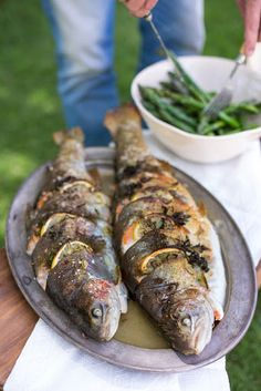 Whole baked trout, stuffed with fennel, lemon & herbs (photography by Tasha Seccombe, styling by Nicola Pretorius) As we are gearing up for another summery festive season, many of us are starting to Herb Recipes, Grilling Recipes, Fish Recipes, Seafood Recipes, Cooking Recipes, Healthy Recipes, Whole Trout Recipes, Salad Recipes, Baked Trout