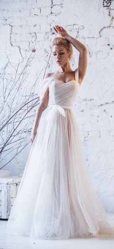 adcc99caff2c16b This unique tulle a-line lace wedding dress off the shoulder by @fataiperya  compares