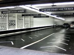 Example of Signage using typography throughout a car park to direct drivers what to do and where to go - parking garage, Midtown Manhattan Park Signage, Wayfinding Signage, Signage Design, Parking Signs, Car Parking, Parking Lot, Environmental Graphic Design, Environmental Graphics, Underground Garage