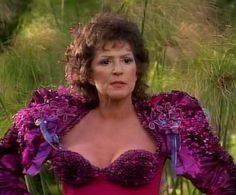 Lwaxana Troi, radiant even in the most questionable couture (it wants to be McQueen, but isn't--yet I still kinda love it.)