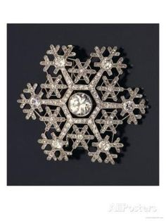 a snowflake brooch designed by Carl Faberge and hand-crafted by Albert Holmstrom in St. Petersburg around 1913.|  AllPosters.es by karen.x