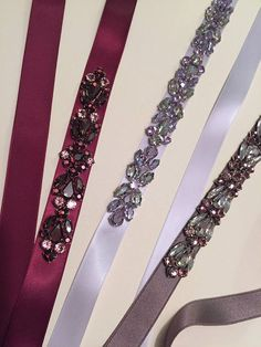 This stunning Deep Burgundy Wine Crystal Embellished Satin Ribbon Sash is an elegant addition to your bridal or bridesmaids dress! Pairs beautifully with shades of dusty orchid, grey, and wine. Each piece is designed and handmade in NYC. Deep Burgundy Wine Satin Sash is 3/4 wide
