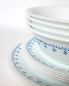 "12-Pc Corelle ""Snowflake Blue"" Dinnerware Set  -Service for 4- Garland Blue & White Dishes and Bowls. $28.00, via Etsy."