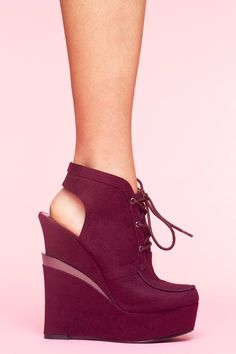 With the gorgeous plum color, and sexy cut out heel, these are a sexy little addition to any outfit!