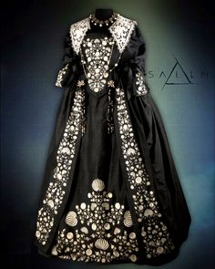 Dress worn by Mary Sibley season 2.  Black silk taffeta with white floral hand embroidery based on an early 18th century pattern.