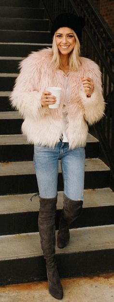 #winter #outfits pink fur bolero with blue denim jeans and brown suede thigh-high boots