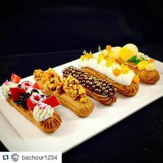 "#Repost @bachour1234 with @repostapp  ""Eclair"" Berries and Cream/ Caramel and Popcorn/ Chocolate / Coconut and Mango / Passion Fruit #TagsForLikes #Bachour #bachourchocolate #bachourchocolatebook #bachoursimplybeautiful #chocolate #theartofplating #chefstalk #chefsofinstagram #gastroart #antoniobachour #bachour1234 #valrhona by goodsweet_"