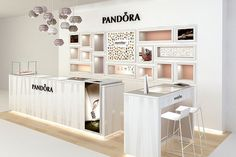 With a personality and DNA so uniquely different from other jewellery brands, Pandora called for an equally unique store design, freeing the myriad of charms from glass counters, allowing clients to interact and try each charm on their wrists. Shoe Store Design, Jewelry Store Design, Jewelry Stores, Diy Jewelry, Jewelry Box, Paper Jewelry, Jewelry Armoire, Wooden Jewelry, Jewelry Bracelets
