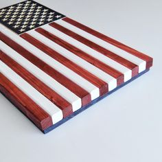 """""""Charred Subdued American Flag Our wooden American Flags are handcrafted to the size of your choosing. They make a great gift or add a patriotic touch to any home or office space. Our Charred Subdued American Flag has alternating charred and blackened wood detailing while keeping the classic American flag layout. ++Frame finish in photo is Dark Ebony++ *TO ORDER* Please specify in cart checkout note box, frame color choice if frame is chosen. This listing is for our Charred Subdued American Flag Wooden American Flag, Wooden Flag, Wood Detail, Porch Decorating, Great Gifts, Rustic, Pure Products, Flags, Crafts"""
