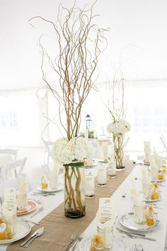 manzanita branch centerpieces // photo by Kina Wicks // http://ruffledblog.com/romantic-illinois-farm-wedding