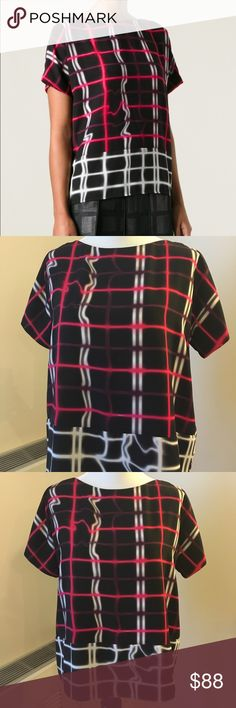 """Kenzo Electric Neon Black Plaid Top Shirt M 8 40 This is a bold short sleep loose fitting top by Kenzo in black with a neon windowpane plaid design in pink and purple with black and white accent.   Beautiful and in perfect like new condition - just too flashy for me! Size 40 French or 8 US which measures bust 42"""", about 40"""" through body, top is 23"""" long. Kenzo Tops Blouses"""