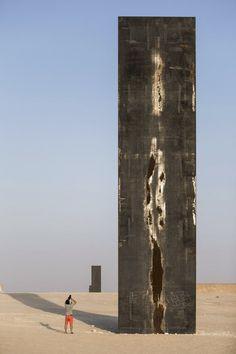 http://www.archdaily.com/626191/richard-serra-s-east-west-west-east-rises-in-the-qatari-desert/