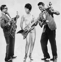 """Lending her inimitable style to the grooves (and sleeves) of 1962′s """"Bo Diddley & Company"""" and 1963′s """"Bo Diddley's Beach Party"""" albums, [Norma-Jean Wofford's]  guitar prowess created a stir equalled only by that of her skin-tight gold lamé cat suit. Asked by one dauntless investigator how she managed to get into it, Norma-Jean responded by pulling out an over-sized shoehorn."""