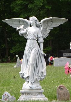 Riverside Cemetary Angel - so cheerful -is the the likeness of a girl buried there?