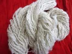 Hand spun alpaca wool/yarn in its natural colour, white with shades and tones of grey by RebeccasWool on Etsy