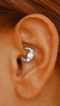 Venus by Maria Tash: Daith princess ring.. It isn't a Tattoo, but I love this..I love the earring as well..sigh..