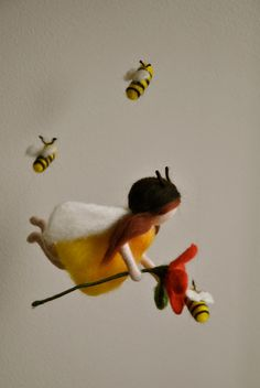 Children Mobile Waldorf inspired needle felted : Bees  fairy with red flower (made to order). $65.00, via Etsy.