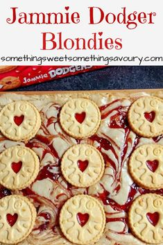 Jammie Dodger blondies: Jammie Dodger blondies - your favourite childhood biscuit baked in delicious, gooey white chocolate jam swirled blondies! Tray Bake Recipes, Uk Recipes, Brownie Recipes, Chocolate Recipes, Sweet Recipes, Baking Recipes Uk, Easy Desserts, Dessert Recipes, White Chocolate Blondies