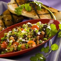 texas caviar recipe - this is like protein-y pico de gallo. i use a few different bright bell peppers, red onion, extra green onions, and italian dressing mix with red wine vinegar and good olive oil. people devour this without ever complaining that there's no queso on the table. blue corn chips are beautiful with this if you remember to get them, too :)