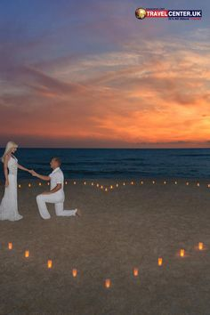 This couple has chosen the best place to propose their love. Surrounded by candles in heart shape, a romantic sunset and a calm beach, everyday is valentines day is at its best! #susnet #beach #valentines #couples #love #goals #hearts #itsallabouttravel #travelcenteruk