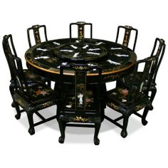 """60in Black Lacquer Dining Table with 8 Chairs by ChinaFurnitureOnline. $2990.00. Dimensions: 60""""Dia. x 30""""H. Inspired by 18th century European interpretations of traditional Chinese motifs, this magnificent dining set is beautifully hand-painted with Chinese peony motif on black lacquered hardwood and decorated with mother of pearl dancing figures. It is an eye catching piece every time when you entertain. Accompanied by eight matching chairs and a removable gl..."""