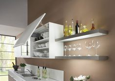 Kitchen lighting has a bit role in the functionality and appeal of any layout. Increasingly LED lights are replacing conventional kitchen lighting due to their cost effectiveness and efficiency. Under Cabinet Lighting, Kitchen Lighting, Kitchen Shelves, Kitchen Decor, Kitchen Ideas, Cuisine Elite, Wardrobe Furniture, Can Lights, Cuisines Design