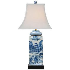 With sleek lines and a delicate pattern, this square jar table lamp is stunning with its blue and white finish. Overall: high. Shade is wide at the top x wide at the bottom x on the slant. From base bottom to shade bottom is 13 Style # at Lamps Plus. Blue And White, Table Lamp, Vintage Table Lamp, Jar Table Lamp, Chinoiserie, Lamps Plus, Fabric Shades, Blue And White Lamp, Ginger Jar Lamp