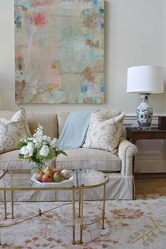 The soft colors, the dreamy art , the green and white flower arrangement – it all comes together beautifully. Design by Jenkins Interiors. Image source.