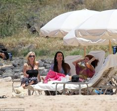 Camille, Kyle and Lisa relax on sun loungers in Hawaii- 2011