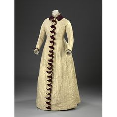 Maroon and yellow pleated folds cascade down the front of this dress concealing the button fastenings. The frills are composed of two narrow...