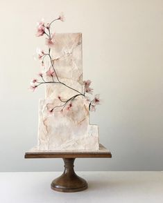 Bride to Be Reading ~ Minimal and beautiful wedding cake with simple addition of floral branch. Strikes us as a Japanese influenced design.