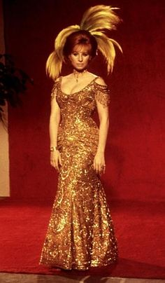 Barbra Streisand in gold Hello Dolly dress.    http://www.nypost.com/rw/nypost/2011/06/01/pulse/web_galleries/g_auction/auction4--350x600.jpg
