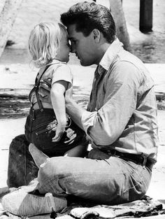 "Elvis with his daughter Little Lisa-Marie, on the set of ""Follow That Dream"", 1962"