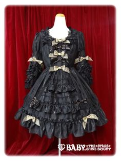 Baby The Stars Shine Bright: Twinkle Doll one piece dress in black http://www.babyssb.co.jp/shopping/baby/onepiece/136349.html (Gothic Lolita)